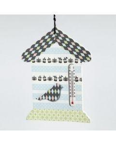 Een thermometer huis versierd met masking tape
