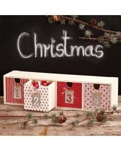 Decoupage op een kleine ladenkast voor Advent cadeaus