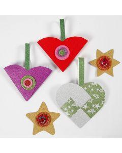Papieren kerstdecoraties met glitter gemaakt met materialen uit de Kerst Hobbybox
