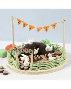 Miniatuur wereld met konijnen en wortelen