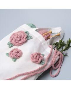 Boodschappentas gedecoreerd met gepunnikte rozen