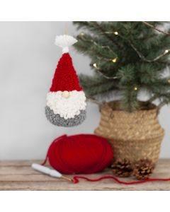 Met punchnaald geborduurde kerstkabouter