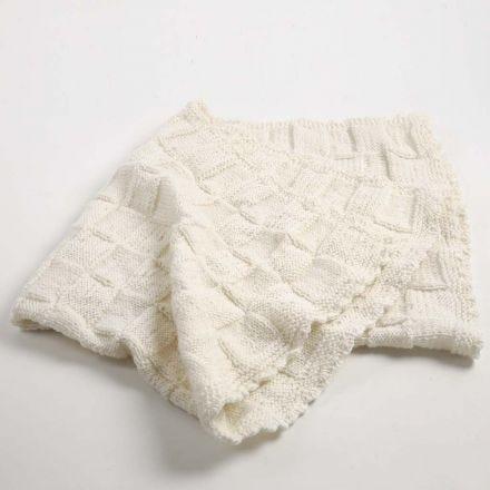 Een gebreid baby dekentje