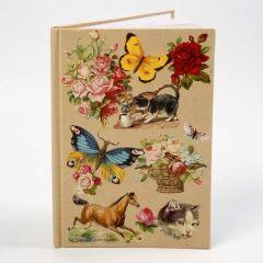 Een notitieboek met een collage van vintage Die-Cuts