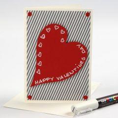 Een Valentijnskaart van design papier met een rood hart