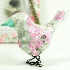 Een vogel met decoupage en poten van bloemendraad