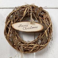 Kerstkrans voor de voordeur met kerstgroet