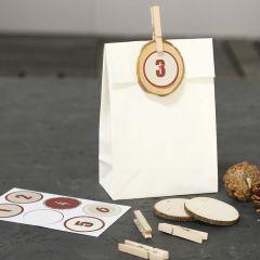 Gedecoreerde papieren zakken voor Advent