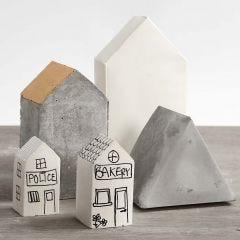 Huizen gegoten in vouwbare mallen