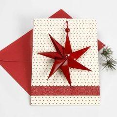 Kerstkaart met zevenpuntige ster aan een lint