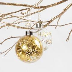 Glazen kerstbal met gouden sterren