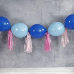 Slinger van verbonden ballonnen en tassels