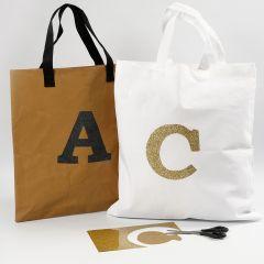 Hoe opstrijkfolie over te brengen op stof en faux leather papier
