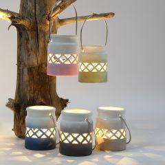 Waxinelichten gedecoreerd in verschillende kleuren