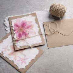 Zelf papier maken en gedecoreerd met servet