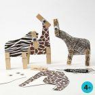 Wilde dieren gemaakt van karton met opdruk en houten wasknijpers