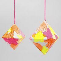 Een papieren diamant met neon prints