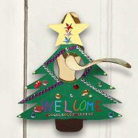 Een geverfd en gedecoreerd bord voor kerst