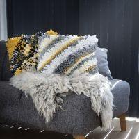 Geknoopt kussen van textielgaren