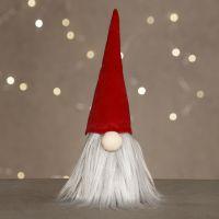 A nosy elf with a long beard and a velvet elf's hat